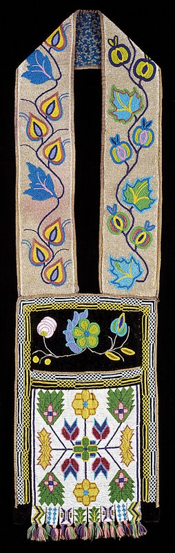 "straps: all over applique beadwork in floral motif on crystal ground; beaded on muslin. Bag: upper panel of applique beadwork flowers on black velvet; center panel of loomed beadwork in floral pattern on a white ground; ""memory tabs"" at bottom of bag with wool yarn tassels"