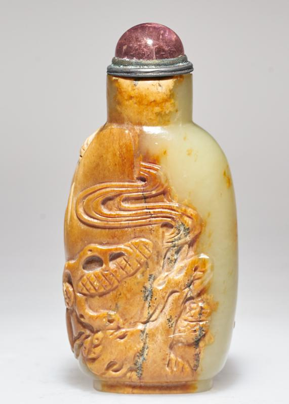 snuff bottle carved mountain and temple on one side and landscape on the other; brown and green jade; tourmaline and silver stopper