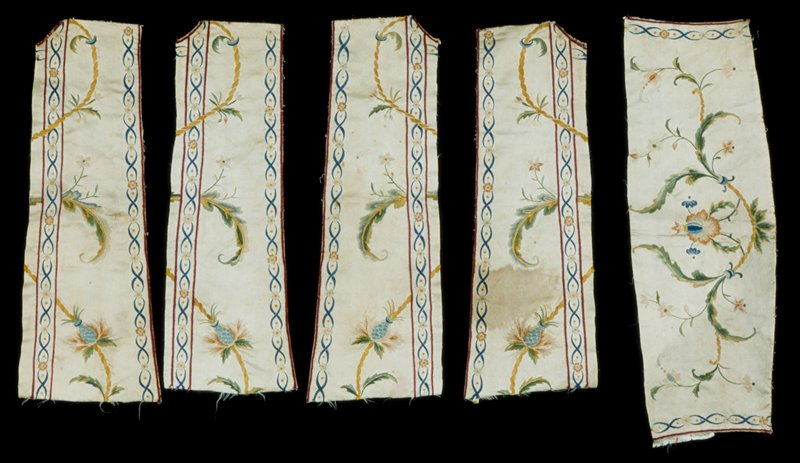 Five fragments from a waistcoat, silk, embroidered with floral motifs on cream ground.