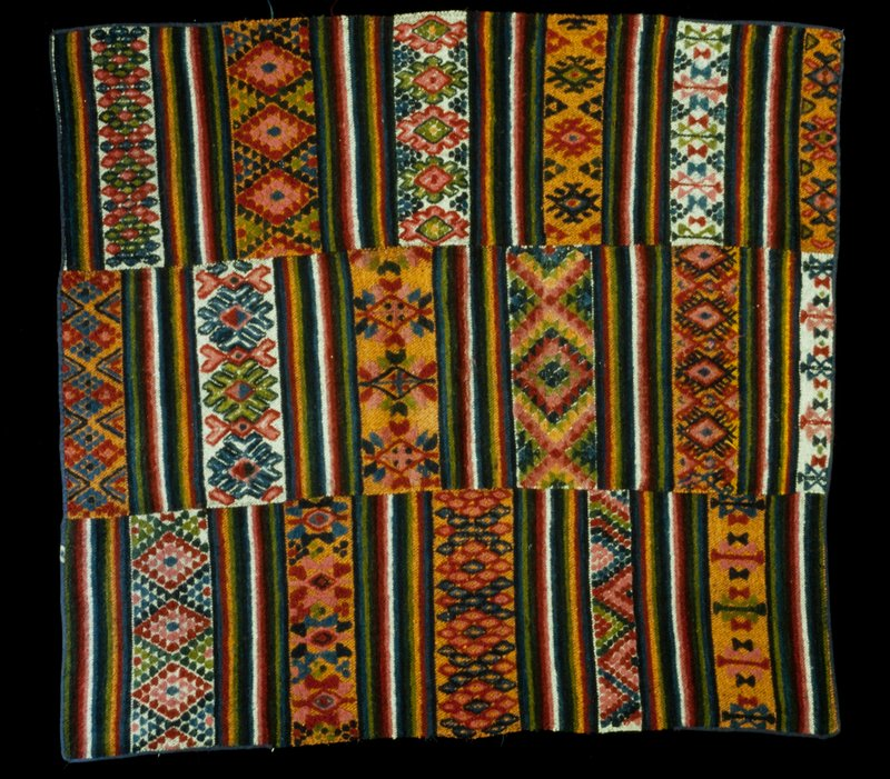 Yattha Charkhab; triple panel wool brocade on wool background; horizontal stripes in reds, blues, orange, greeen, white with same color discontinuous supplementary weft design; ends bound with blue cotton.