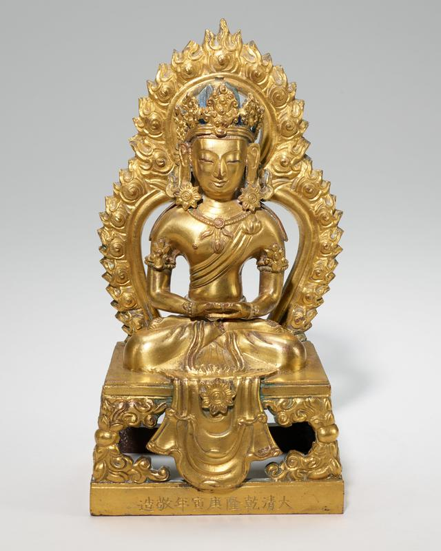 one of pair of Bodhisattvas crowned, seated in Dhyana (meditation) mudra on thrones with flame halo; gilt bronze; Tibetan