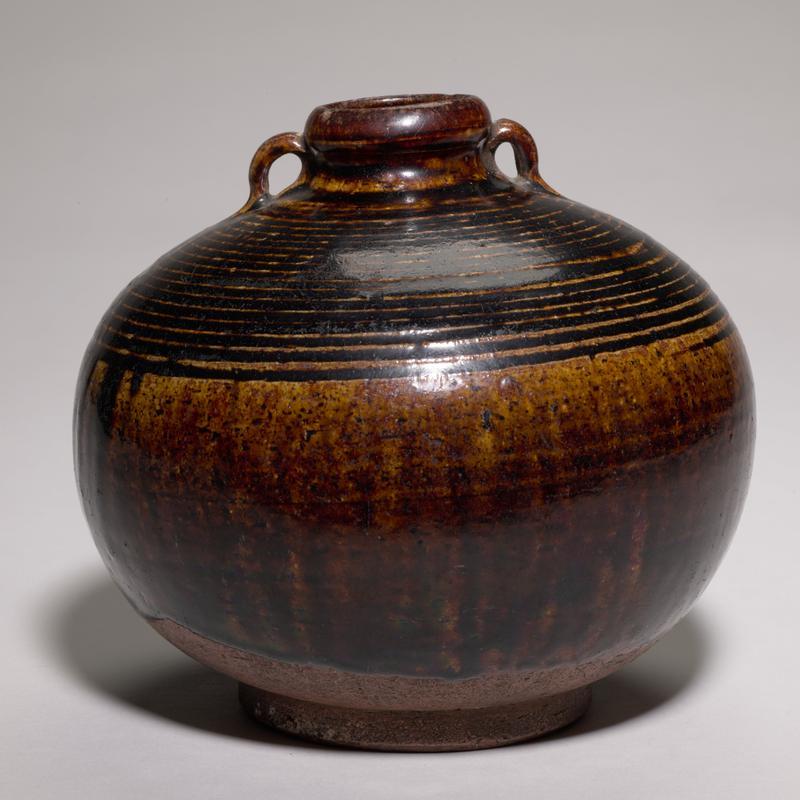 Sawankhalok jar globular shape on ring foot, short neck and small mouth, loop handles; dark brown glaze, lines circling top half of jar
