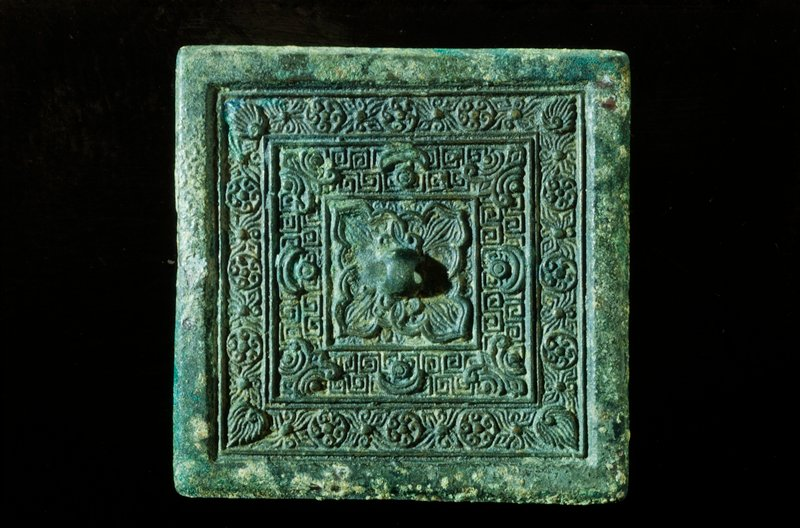 mirror square, large floral design surrounded by key, sun and moon motifs