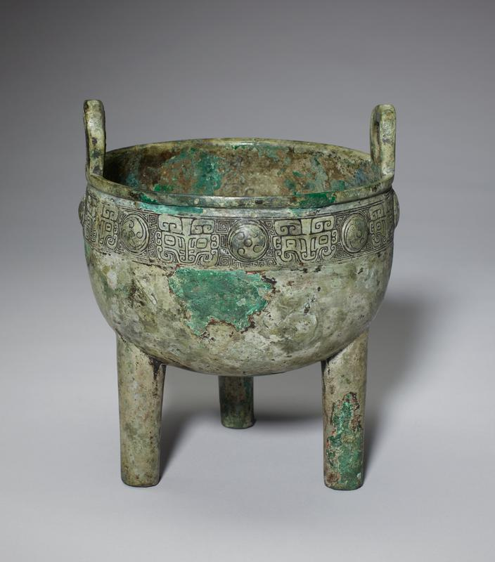 bowl with loop handles on three legs; band of t'ao-t'ieh masks and medallions surrounding rim