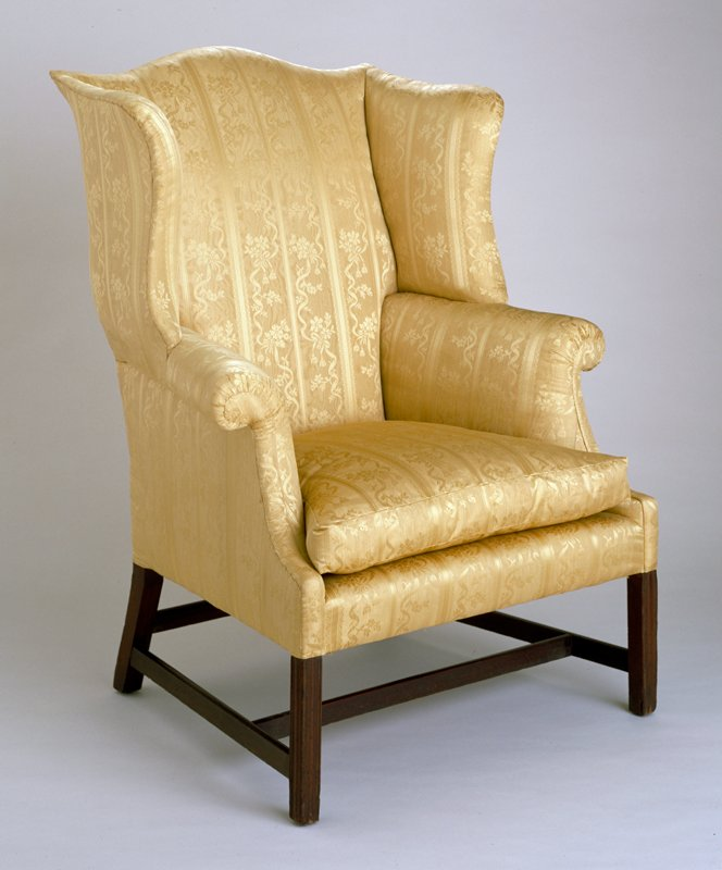 Easy Chair, mahogany, c.1800, serpentine crest rail, shaped wings, rolled arms, molded front legs connected by stretchers. White pine secondary wood.