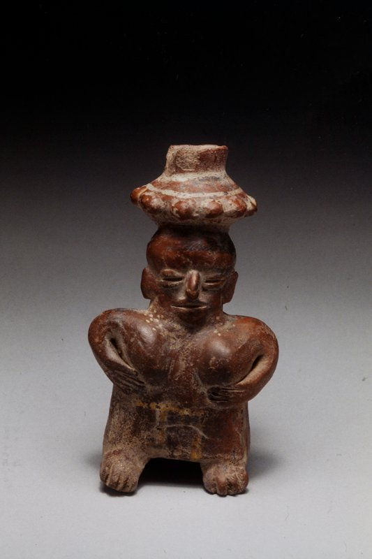 Standing Female Figure with Bowl on Head, Chinesco type; burnished red slip with traces of black and yellow pigments; ceramic, West Mexican, 250BC - 300AD NO PHOTO ON CAT. CARD cat. card dims H 5-1/2'