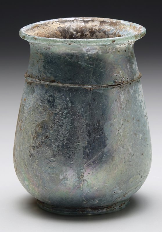 blue vessel with narrow applied band at neck; glass