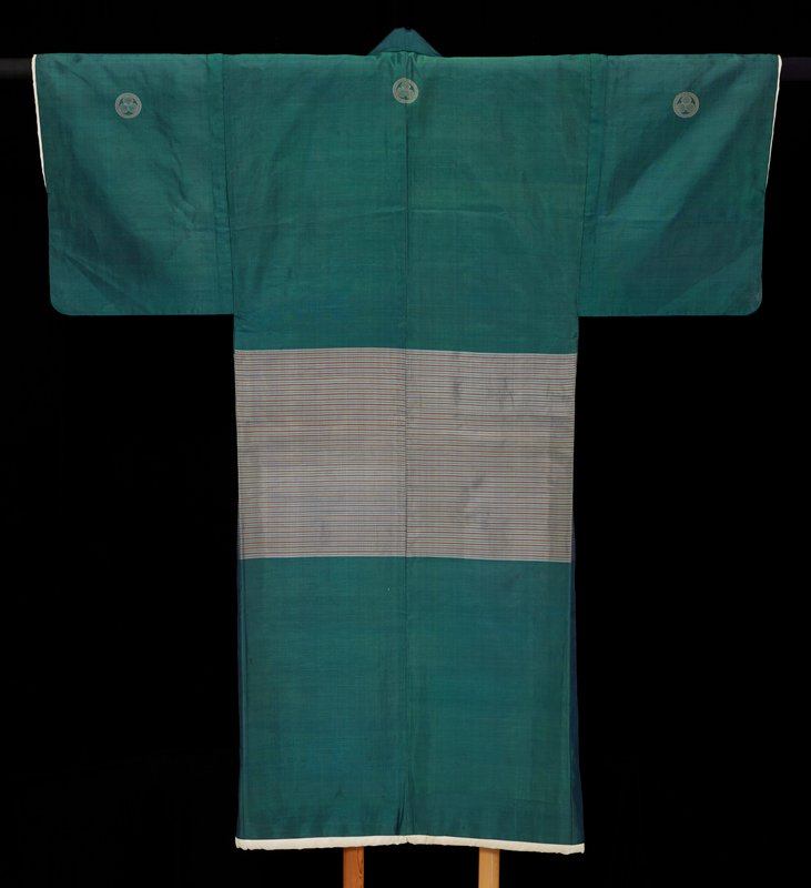 Man's Kimono, Meiji Period, 1868-1912, green silk with padded sleeves and hem, lined.