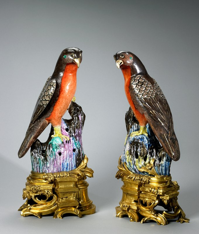 pair of sparrow hawks, porcelain birds of Chinese Exportware, Ch'ien Lung Period (1736-1795), mounted on bases of chased and gilded bronze, French, Louis XV Period (1710-1774).