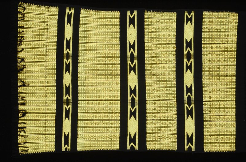 Black ground with a mixed thread of yellow and gold supplementary weft patterning