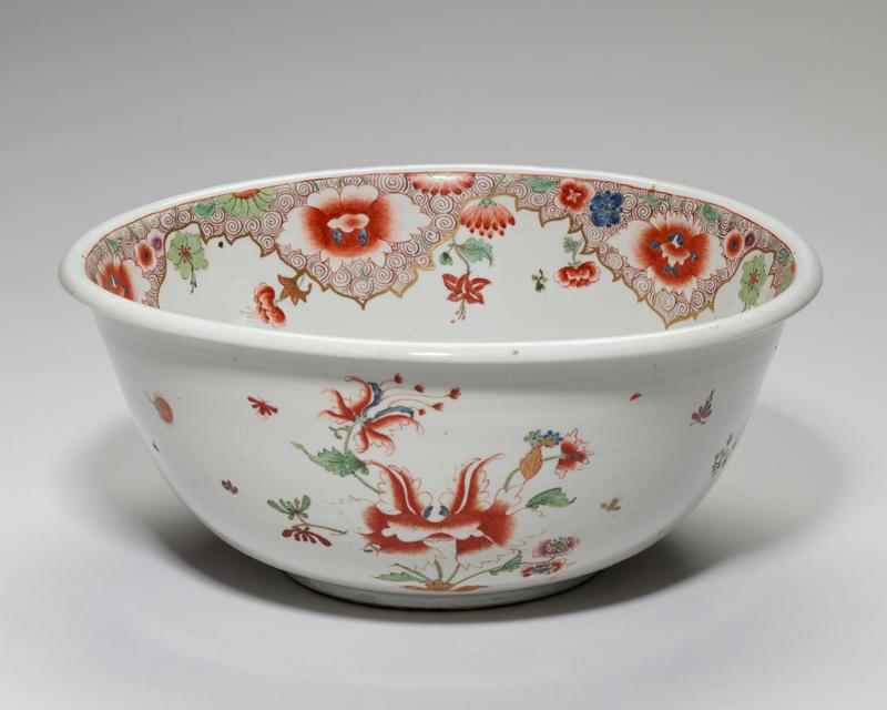 porcelain; with pictures of small animals and flowers underglaze, of Chinese influence.