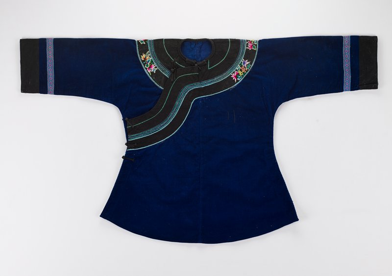 blue corduroy, black cotton, woven and embroidered decorative bands at sleeves, neck and front