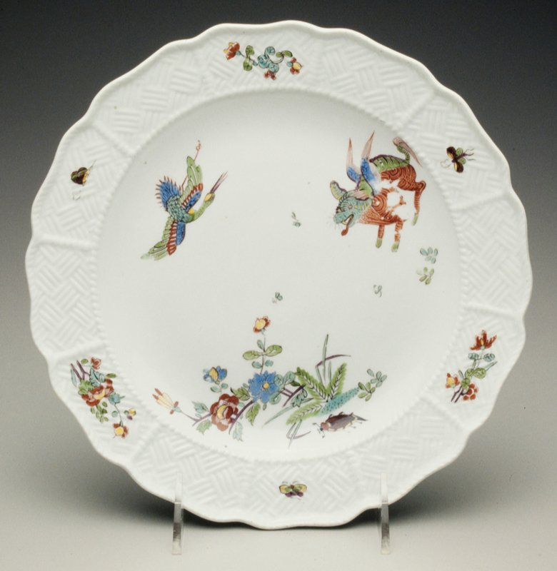 Kakiemon style with winged beast, flying crane, insects, grasses, spays in indianische blumen within a Sulkowski Osier border