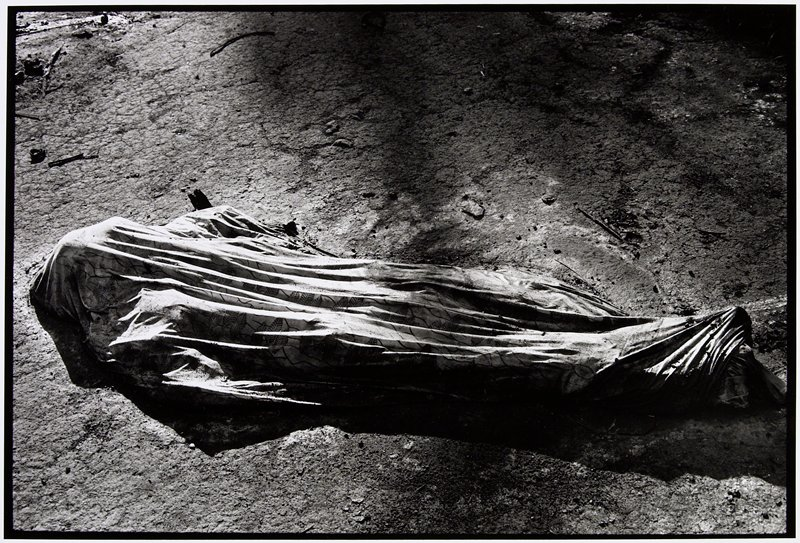 body wrapped in a large cloth