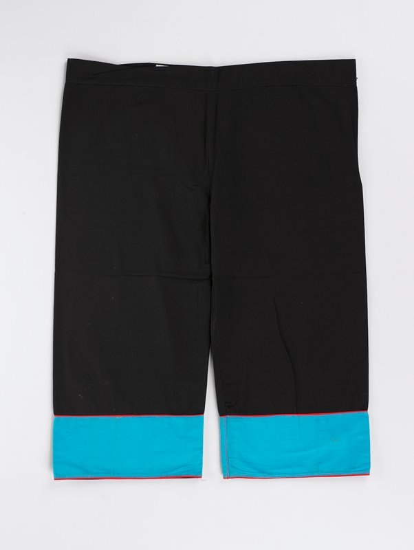 black pants with light blue cuffs; cuffs have red bands on top and bottom