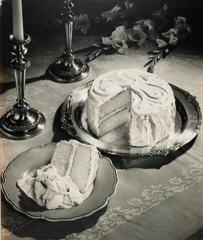 cake with white frosting; black and white