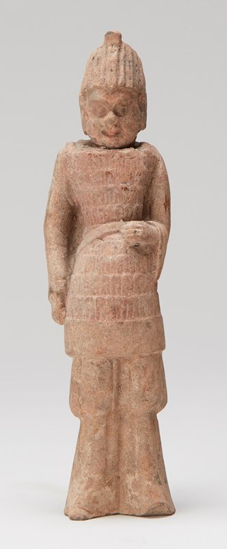 ceramic standing soldier figure; traces of black and red pigment