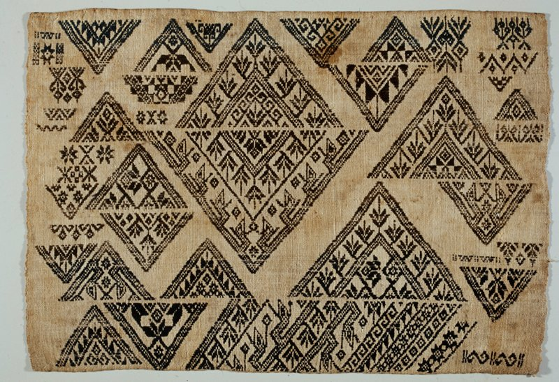 single panel, beige ground with fragmented banding of blue and brown; colors limited to a particular area blue, brown, blue bands; diamond and geometric discontinuous supplimentary weft patterning; all sides finished