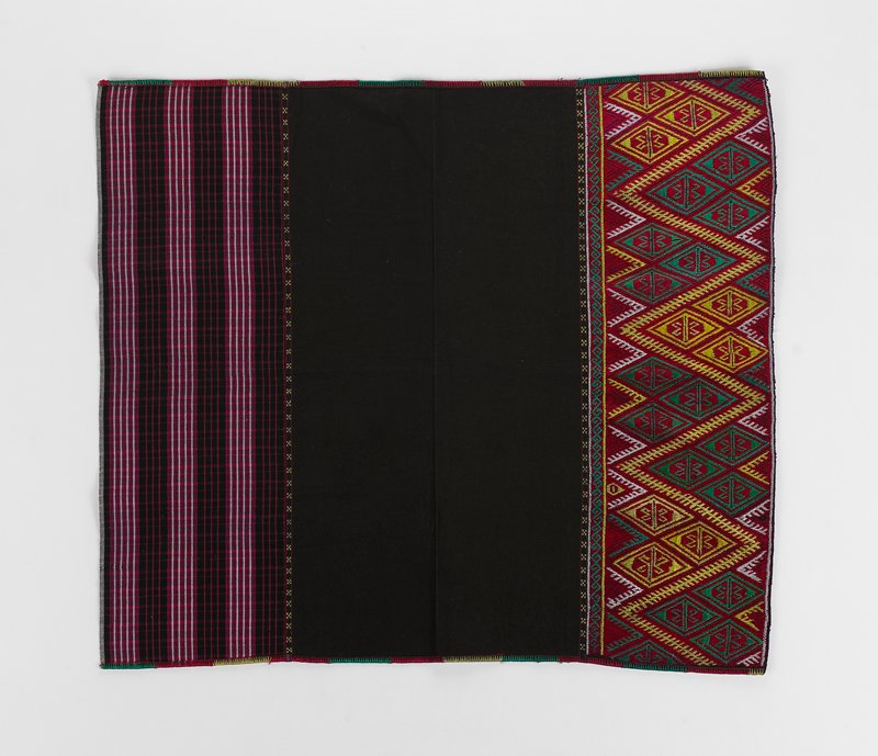 three bands; top band of checked pattern in white, purple and black; central band of solid brown; lower band of diamond patterns in yellow, green and white; sides finished in yellow, red and green