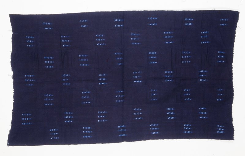 indigo field with diagonal squares, each having three stripes of four to six chevrons of lighter blue; short sides unfinished