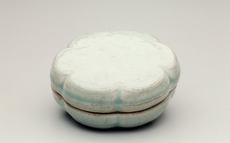 light green six-lobed box with flower design on lid; in storage box