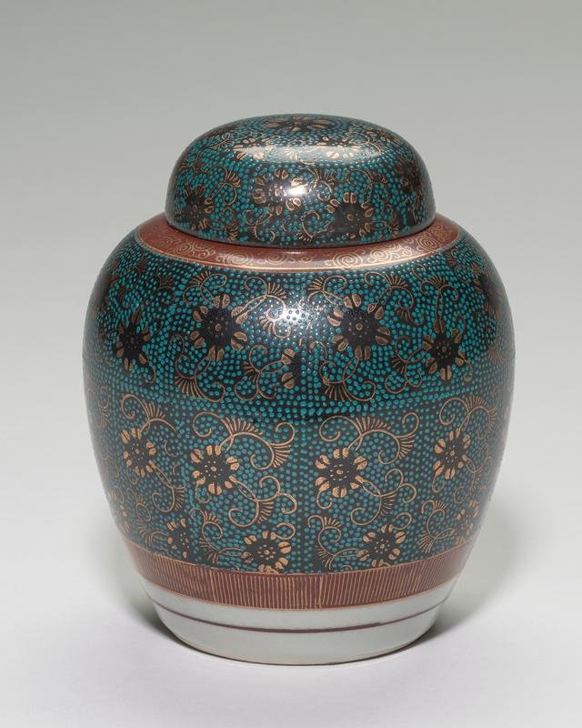 covered porcelain ginger jar; black ground with applied rectangular stipple patterns in which gold veins and flowers intertwine; four green felt feet