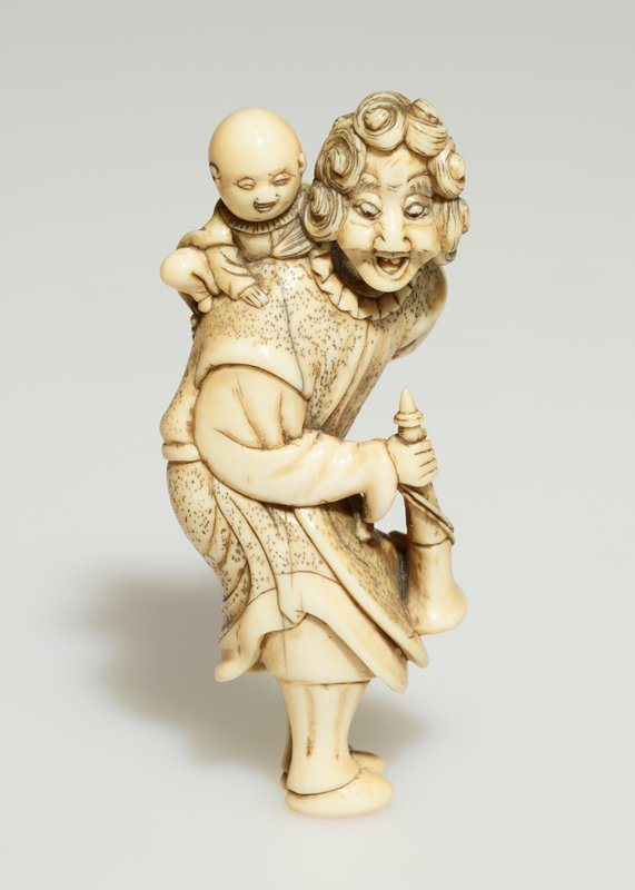 curly-haired man holding a trumpet in his proper right hand curls his proper left arm behind him to hold a small boy on his proper right shoulder; man is bent at waist