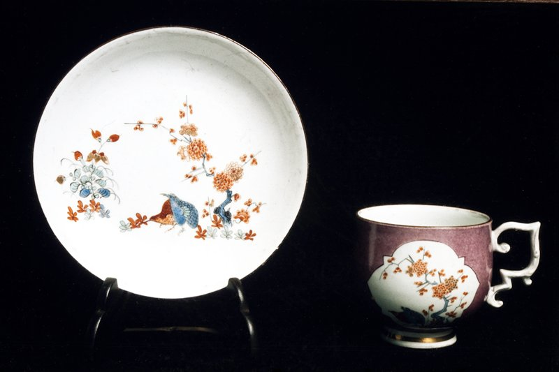 teacup, ceramic, cat. card dims diam 2-5/8 x H 2-1/2'; cup has a lavendar ground with two panels with variety of kakeimon pattern with partridges