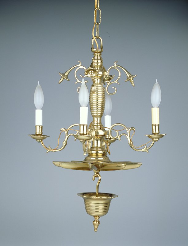 oil lamp converted into electrified hanging lamp; candelabra with 4 candle cups (converted to lamp sockets) extending from scrolling arms near base; four organic, protruding arms near top above candle cups; applied star-shaped base with separate cup-shaped hanging pendant; electrical works removed per request of E. Maurer for installation 6/16/2000