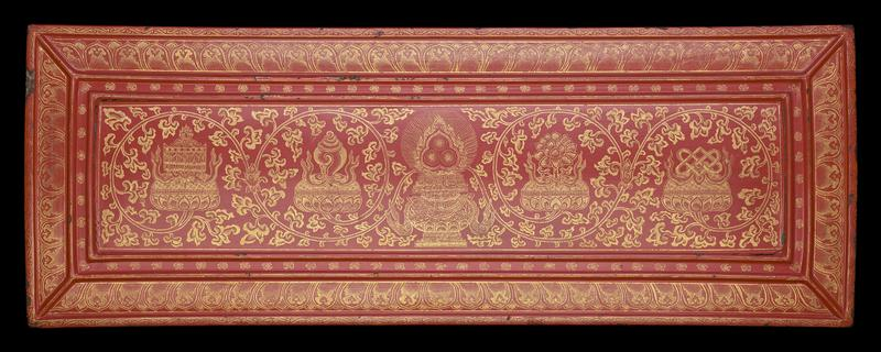 Red lacquer panel, carved and inlaid with gold; compartmentalized top with organic repeating designs around edges; central section with vessel at center sprouting long, curling stems with four cushionlike flowers which support various unindentified objects