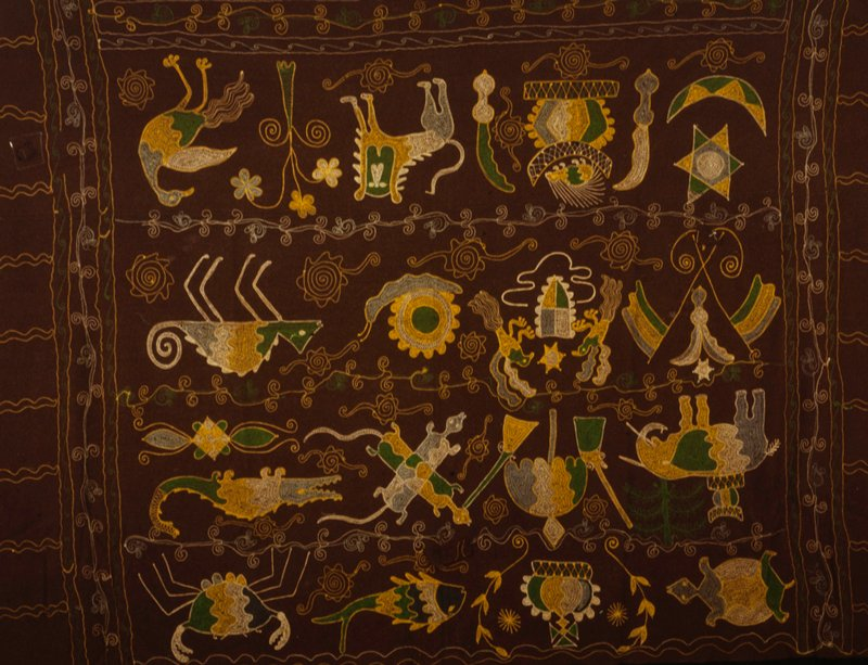 hanging, wool with multicolored chainstitch embroidery; motifs include lion, elephant, stool, swords, birds, crocodiles, fish