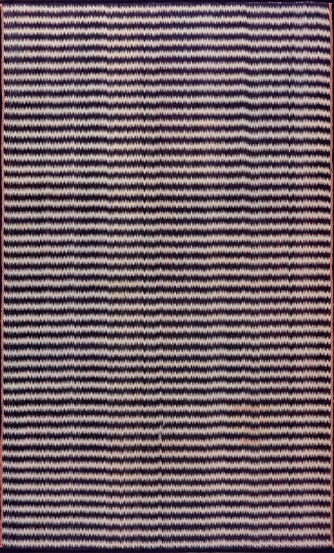 Mushru Cloth, Mughal Period, late XVII-early XVIII century. Ikat dyed (indigo over cochineal). 'Mushru' means 'permitted'. Under the laws of the Koran pure silk could not be worn by men, but with cotton or linen wefts, it was permitted as a lining material for a garment at court.