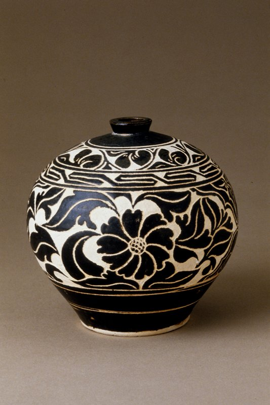 Small Jar, Ts'u-chou ware; stoneware with clear glaze on black and white slip and sgraffito (carved) floral decoration
