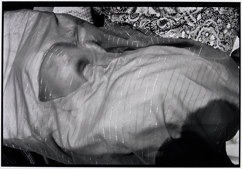 baby wrapped in cloth with face showing through
