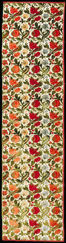cut and uncut velvet panel with flower heads and foliage designs.