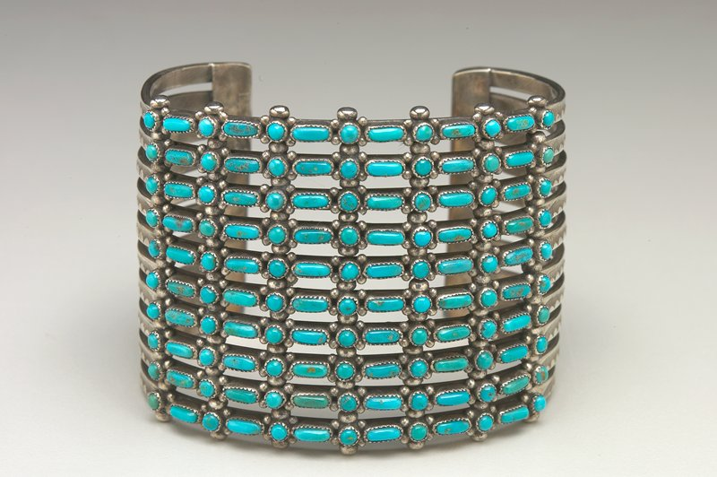 10 Bands, each set with thirteen small round and elliptical turquoises in needlepoint style, serrated bezels; teardrop and stamped decoration cat. 342, J#114