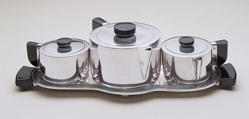 Silver plate with Bakelite handles