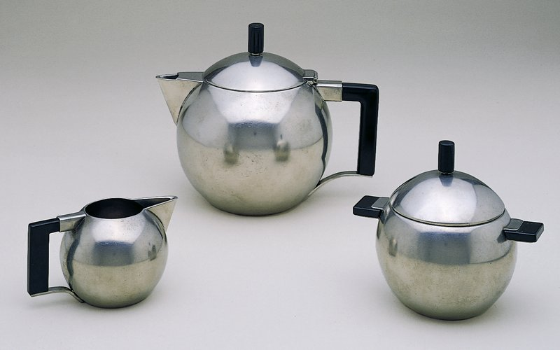 Spherical teapot with black handle and finial