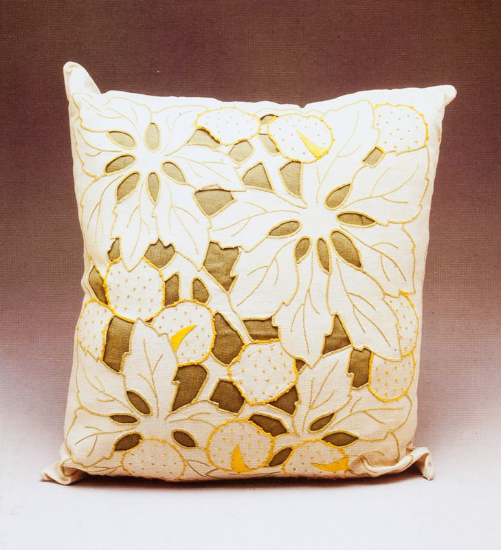 Hand embrodiered linen with cut-out design