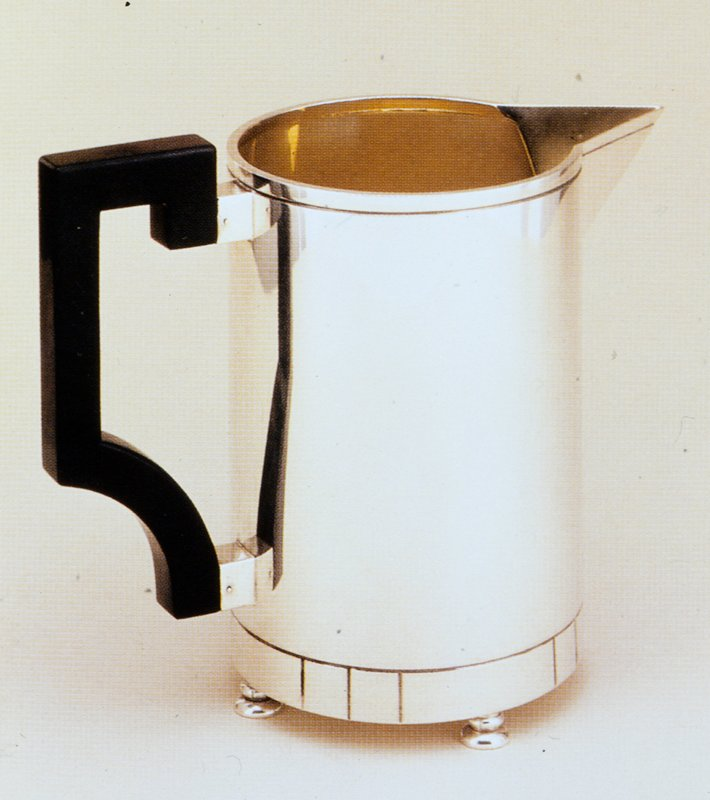 Sterling silver with gilt interior and Bakelite handle