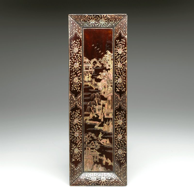brown lacquer with inlaid mother-of-pearl; flaring edges on a short foot; floral patterns at edges; winding river with figures, buildings, boats and bridges at center