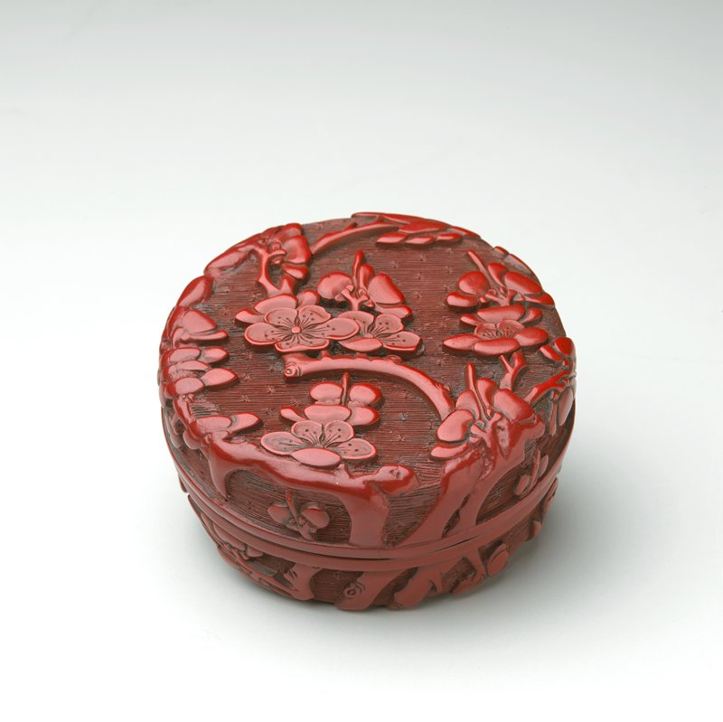 cover and bottom carved with allover design of prunus flowers and branches against background of lines and dots; carved red lacquer