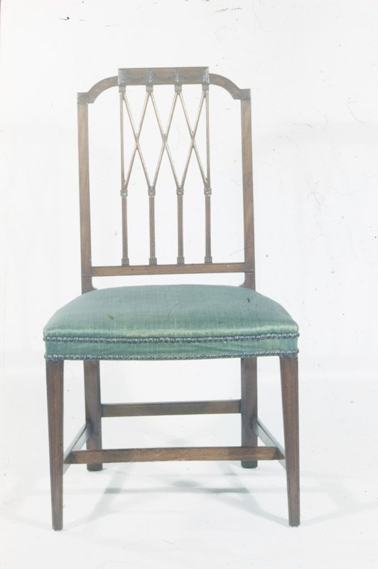 side chair, Sheraton design; open back of 'diamond pattern'; rectangular panel carved with drapery swags in center of crest rail; straight molded legs taper slightly; underbraced with stretchers; seat upholstered in green silk damask (modern)