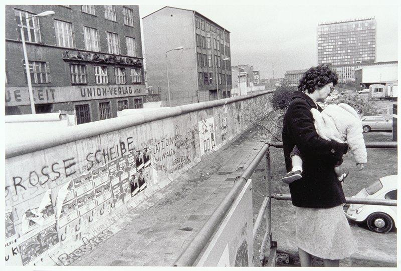woman and child at Berlin Wall