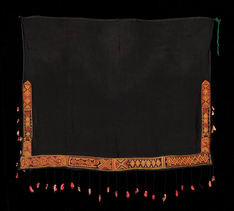 black fabric with orange, light green and fuschia geometric embroidery on bottom edge and halfway up R and L edges; black threads with red, fuschia and pink tassels at embroidered edges; green tie at UR corner