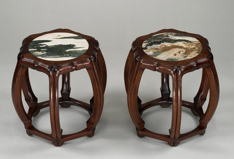 6 lobed legs, curving outward and in, resting on a hexagonal raised base; marble top with green, grey and burnt orange swirls on creamy white