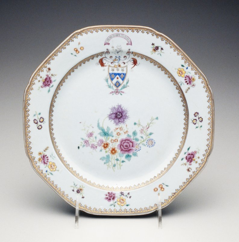 octagonal; gray glaze; floral center; border with flower sprigs; gilt rim; coat of arms and motto 'I Mean Harm to None'