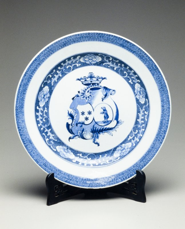 armorial blue and white dish, coat of arms within shell scroll, peony cluster border 12-1/2 in. diameter, Arms of Peers of Baraud accollee with Maraschal of Forez