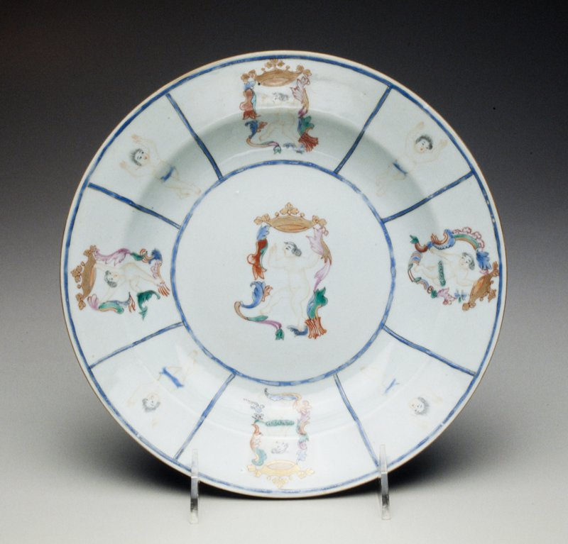 soup plate with center decoration of nude boy dancing below salmon and gilt coronet, rim with similar cartouches of tiptoeing boys with raised hands