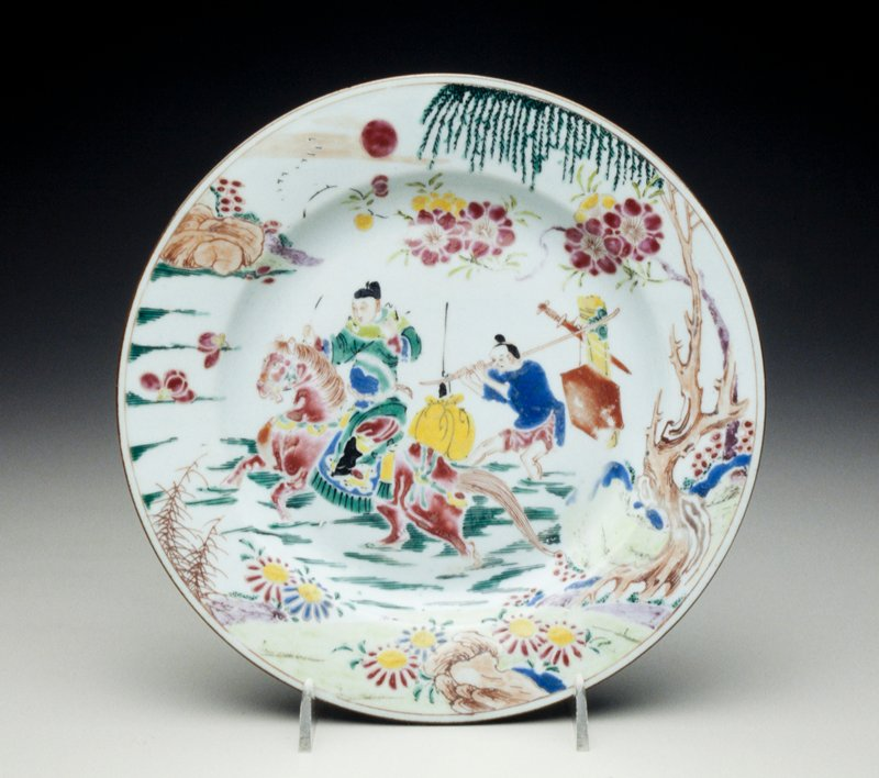 plate decorated with civil official on horseback crossing river, an attendent wading behind with laden yoke, willow and peony tree